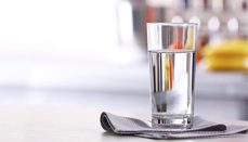 A glass of purified water on dining table