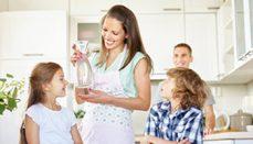 A family enjoying perks of purified water